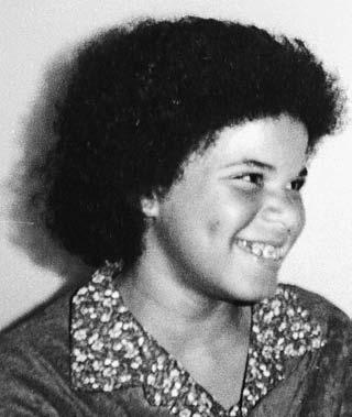 I was taken to a back room where, inexplicably, my hair was cut very short and I was given a Jheri curl. The curl was put on top of the relaxer that had been applied to my natural curls.