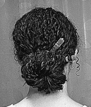You can also tie most of your hair in a single or double knot (see the photos above). Divide your hair into thirds.