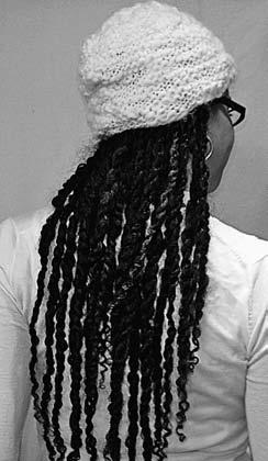 250 Curly Like Me Twists with a hat. Twists in a bun, with bamboo chopsticks. airport, by undoing a twist and finger-combing it gently before twisting it back up again.
