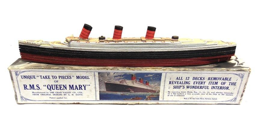 Lot 240 240 A CHAD VALLEY SECTIONAL 'TAKE TO PIECES' MODEL OF THE R.M.S. QUEEN MARY complete and boxed (box tray with splits to sides of one end panel).