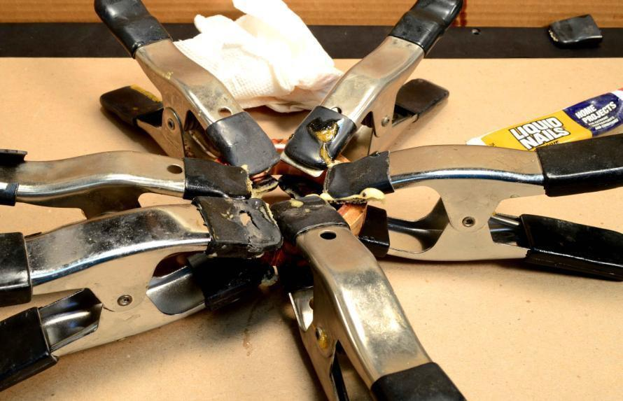 Step Eleven: Use clamps to hold the pieces together while the