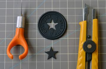 Rubber Star Badge For a different style of All-Stars, like the all-black kind: Use a seam ripper or small pair of scissors to cut the threads holding the rubber star badge to the shoe.