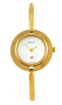 126 127 129 GUCCI - a lady s Interchangeable bracelet watch. Reference 11/12, serial 0537859. Signed quartz movement. White dial.
