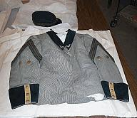 The New York Historical Society Buch Uniform 1957.277a Uniform Jacket Dated: 1865-1870 Cotton, wool, metal, silk Overall: 3 x 18 1/2 x 26 1/4 in. ( 7.6 x 47 x 66.