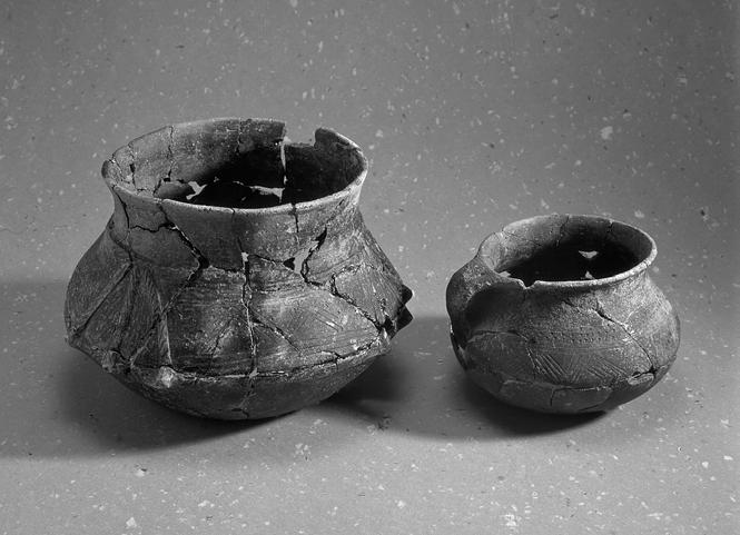 Fig. 10. Two pottery vessels. Ca. 1:4. Photo Bengt Almgren. ornamentation are rather early in the series. This type without animal heads belongs to the late part of the 4th century.