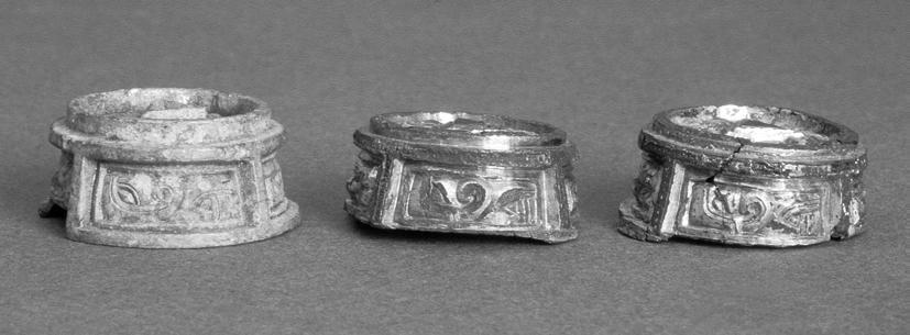 Fig. 7. Gilded clasp-buttons from Nicktuna and unfinished button from Helgö with equivalent mould fragments. Photo ATA.