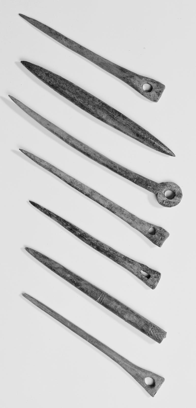 Fig.12 Bone pins and weaving tools from the Royal Opera House site (photo A Chopping, MoLAS). front face, the annulets from the reverse).