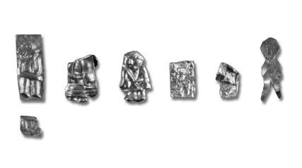 Fig. 2. Gold foil figures, found in a house structure in 2001. 1:1. Photo B. Almgren, LUHM. up direct evidence for metalwork in Uppåkra during the Migration Period.