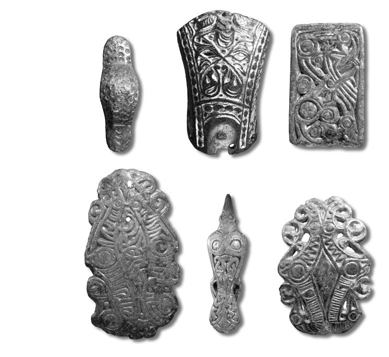 Fig. 9. A collection of Vendel Period brooches. 1:1. Photo B. Almgren, LUHM. with some other type of brooch. The type is clearly south Scandinavian with a distribution from Jutland to Bornholm.