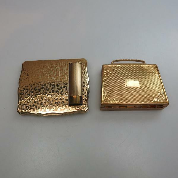 9 cms $150 200 2 Two Gold Tone Metal Compacts the first by