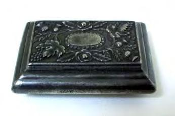Coffin type snuffbox c1830 with cast decorated lid comprising central oval surrounded by roses, thistles, grapes and leaves. In excellent condition, with working hinge and lid that closes properly.