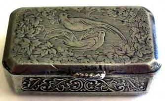 Snuff box with two birds on lid, with cast decorated foliate designs and engine turned all