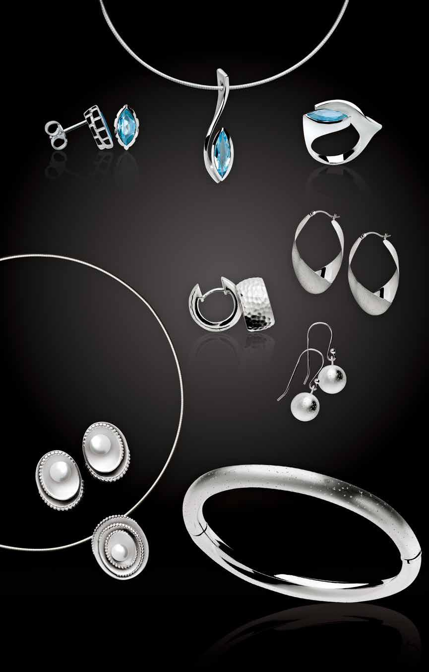 A astian Sterling O L L T O N A. lue topaz earrings, $145. lue topaz pendant, $555. lue topaz ring, $375. ammered hoops, $195.