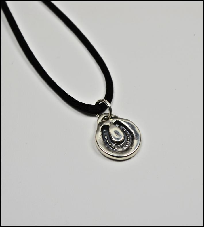 Includes gift box. Pendant $48. Pendant with 16 black satin necklace $68. B.