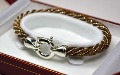 Simple Elegance Bracelet $165 A beautifully elegant 5mm spiral braid is accented by an oversized sterling silver