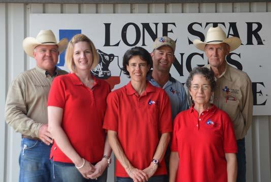 L to R: Doug & Julie Willard, Mark & Karen Janak, and EM & Nancy Holt We are proud of our offering of more than 125+ registered Angus bulls.
