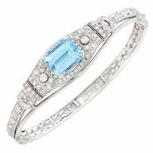 $3,000-4,000 237 White Gold and Aquamarine Ring 18 kt., one oval aquamarine ap. 12.00 cts., ap. 4.7 dwts. Size 5. Estate of an Encino Lady 244 Platinum and Diamond Band Ring 19 round diamonds ap. 2.85 cts.