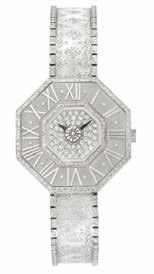 , 58 round diamonds ap. 2.90 cts., signed Webb, ap. 20.0 dwts. $12,000-18,000 476 White Gold and Diamond Oktachron Wristwatch, Gianmaria Buccellati 18 kt., quartz, dia. ap. 26 mm.