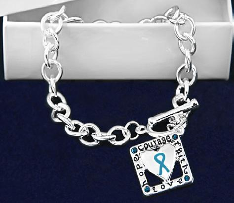 White costume pearl beads with sterling silver plated charms that have teal ribbons. Comes in optional gift box.