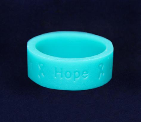 a teal ribbon. The heart is approximately 3.5 cm by 3.75 cm. Comes in an optional gift box.
