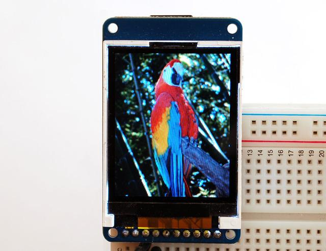 Displaying Bitmaps In this example, we'll show how to display a 128x160 pixel full color bitmap from a microsd card.