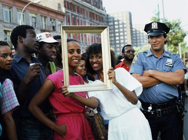 Art Is... (Woman with Man and Cop Watching), 1983/2009. Chromogenic color print, 16 x 20 in. Courtesy Alexander Gray Associates, New York. 2015 Lorraine O Grady/Artist Rights Society (ARS), New York.