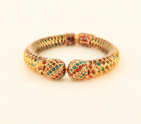 enamel work make this beautifly crafted bangle enchanting to