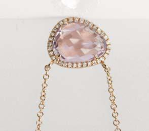 00 B] 14kt rose gold pendant with a single bezel set faceted fancy cut pink