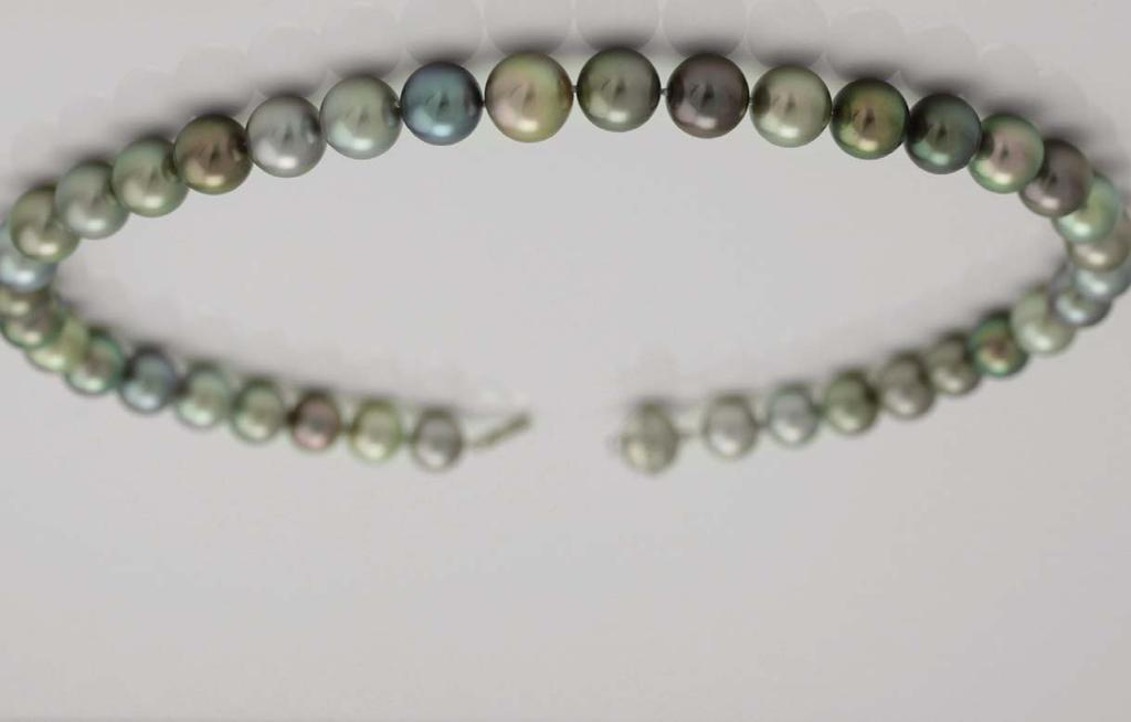 5mm south sea pearl and forty-eight diamonds