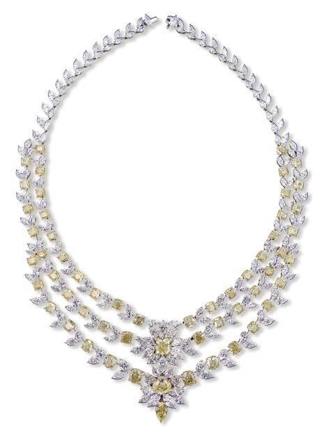 Highlights of the collection include a long, asymmetrical diamond necklace embellished with an 18.