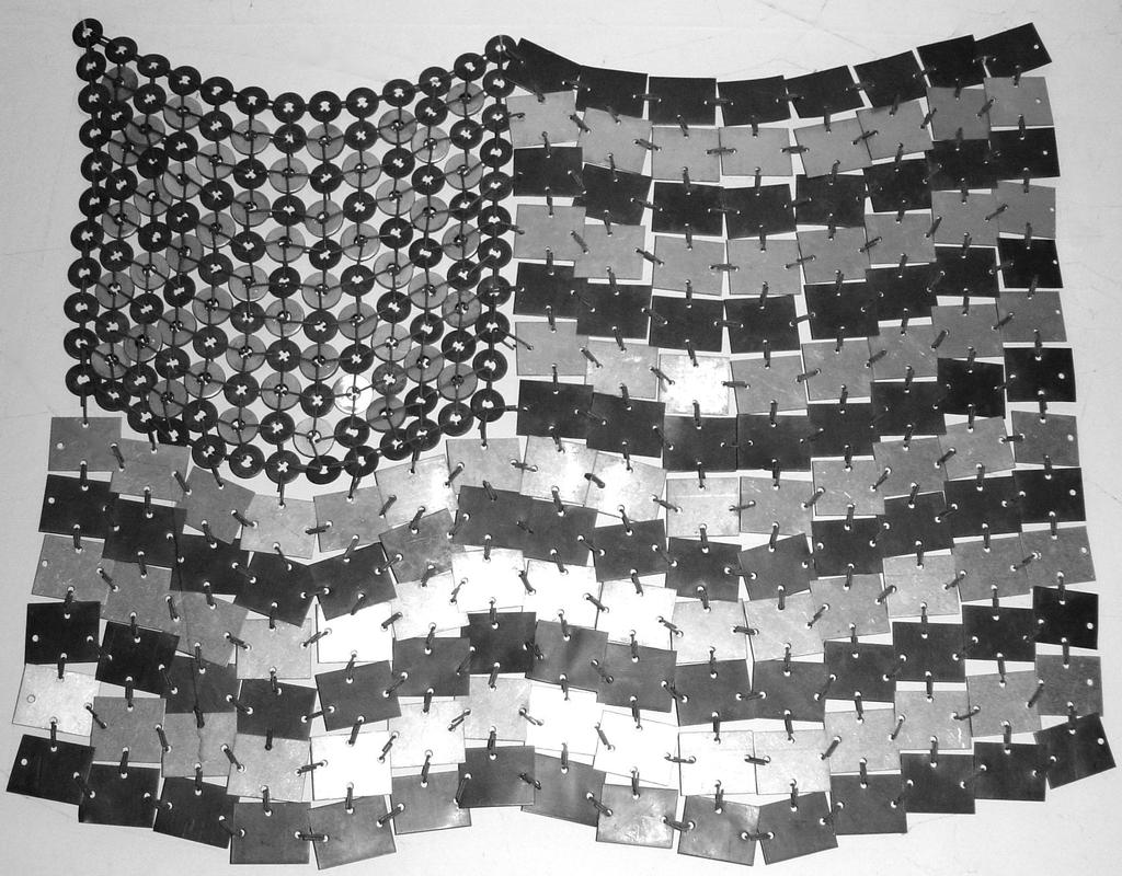 and thus The Impervious Flag (18 x 22, copper, steel and aluminum, 1970) Copper, steel and aluminum were chosen for their durability and weathering factors.