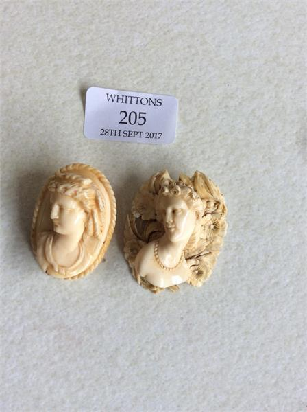 205 Two carved ivory