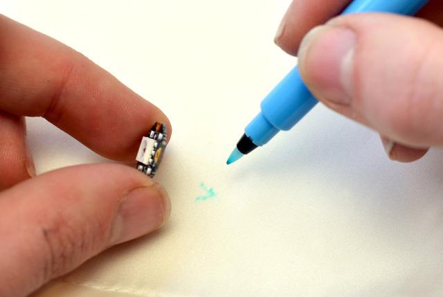 Lift each component and make a mark with a water-soluble marking pen (or just use a very fine tip
