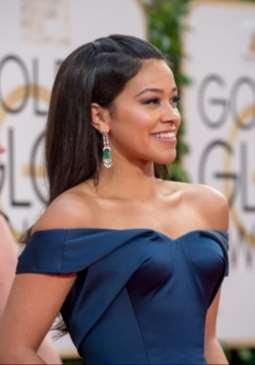 While Gina Rodriguez ( Jane the Virgin ) paired emerald and diamond fringe chandeliers by Neil Lane with her strapless