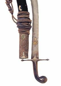268 269 268 A TURKISH KILIG, LATE 18TH/19TH CENTURY with reinforced watered blade of characteristic form, decorated on each side with a small panel of gold koftgari scrollwork towards the tip and a