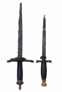 292 293 292 A COMPOSITE DAGGER, CIRCA 1540, DUTCH OR GERMAN in excavated condition, with single-edged blade, iron hilt with slightly up-turned quillons (a forward branch missing), side-ring