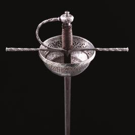 306 307 306 A FINE SPANISH CUP-HILT RAPIER, CIRCA 1680 with slender blade of flattened hexagonal section, stamped Tomas Daiala and En Toledo within a short fuller on the respective faces (rubbed),