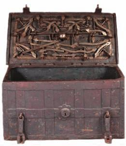 369 369 A GERMAN IRON STRONG BOX, LATE 17TH/18TH CENTURY formed of a series of large iron plates overlaid with broad interlaced iron bands, fitted with a pair of hasps at the front for securing the