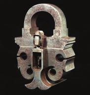 sprung mechanism retained by engraved plates, and stamped with the letters MM at the front, fitted with a small handle at each end, complete with an associated key (pitted throughout) 19.