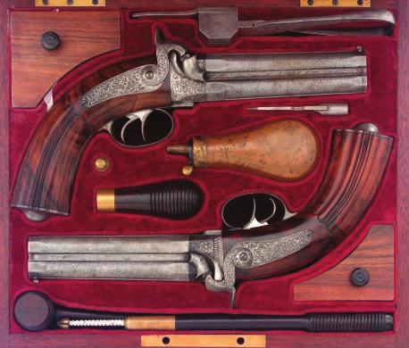 450 450 A PAIR OF SAXON OVER-AND-UNDER RIFLED PERCUSSION PISTOLS BY JANECK IN DRESDEN, CIRCA 1840 with signed etched twist sighted barrels, octagonal breeches and muzzles, rifled with eight grooves,