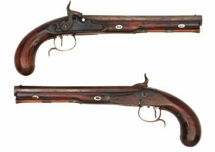 133 133 A PAIR OF PERCUSSION DUELLING PISTOLS BY WOGDON & BARTON, CIRCA 1795-1803 each converted from flintlock, with rebrowned swamped octagonal sighted barrel, engraved breech tang incorporating
