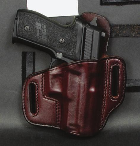 "Fits belts up to 1 3/4"". Available in Black or Saddle Brown: Finish - Plain. Note: For Hand Boned Detail, refer to price list."