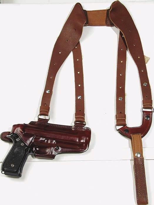 A sewn on belt loop will permit strong side carry. A slot is cut into the belt loop to accommodate a tie down. The double side harness allows easy carry and balance.