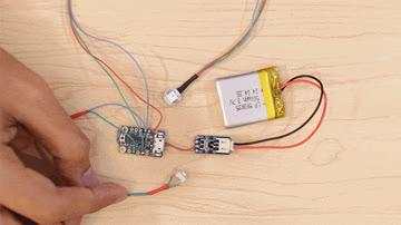 The arduino code should already be uploaded to the Adafruit Trinket