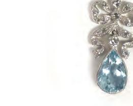pendant of bow shaped form above a teardrop shaped aquamarine. overall 4.