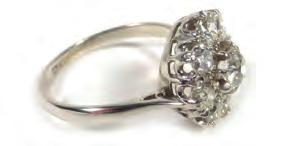 Lot 534 534 A platinum cluster ring set centrally with a brilliant cut diamond in a
