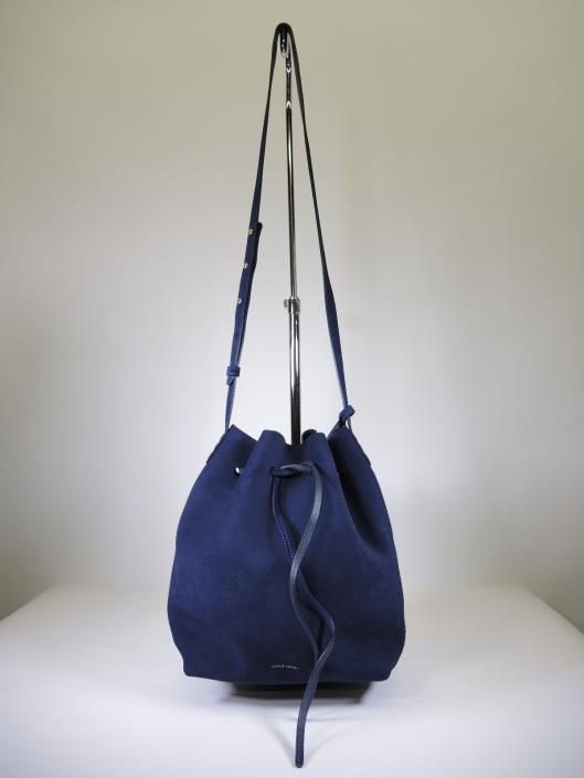 MANSUR GAVRIEL Navy Suede Bucket Bag With Pouch Retailed for $595, sold in one day for $299. 03/04/17 A favorite bag for the trendy gal, the bucket bag by Mansur Gavriel has quickly turned iconic.