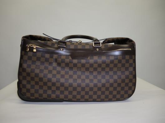 LOUIS VUITTON Eole 50 Rolling Suitcase Retailed for $2340, sold in one day for $1400.