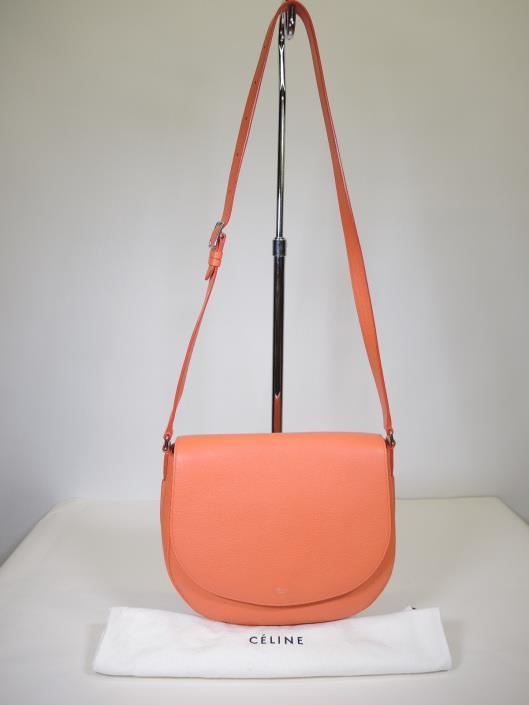 CELINE Coral Trotteur Purse Retailed for $2600, sold in one day for $1000 The Trotteur purse first introduced in 2013, was such a hit for Celine, that each year they release new colors or tweak the