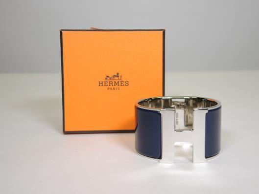 HERMÈS Navy and Silver Click H Extra Large Bracelet Retailed for $830, sold in one day for $599.